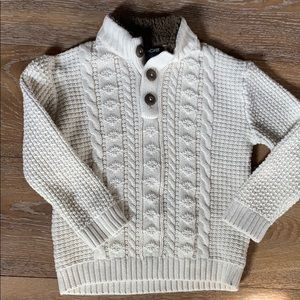 Cream cable knit sweater.
